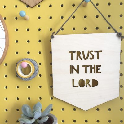 Photograph of a Christian Gift - A Wooden hanging sign with the words Trust in the Lord cut out.