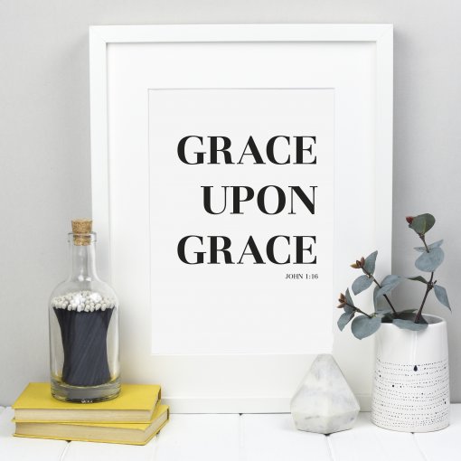 Grace upon grace black on white print shown in a white frame