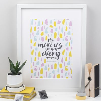 """A styled photograph of a Christian Prints with """"His Mercies Are New Every Morning"""" From Lamentations 3:23 written in a hand lettered font"""